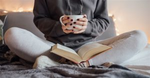 Reading in bed with cuppa