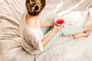 girl with fruit tea sitting on bed-Simply Shine
