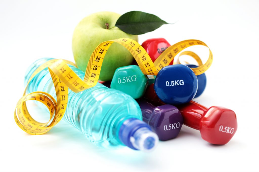 water, weights, apple and tape measure