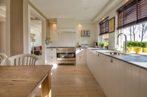 clean kitchen with cooker and sink under window