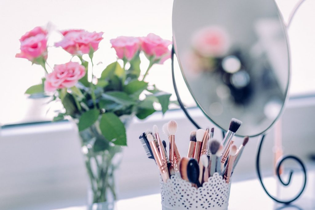 powerful skincare secrets you need to know-dressing table with flowers and make up brushes