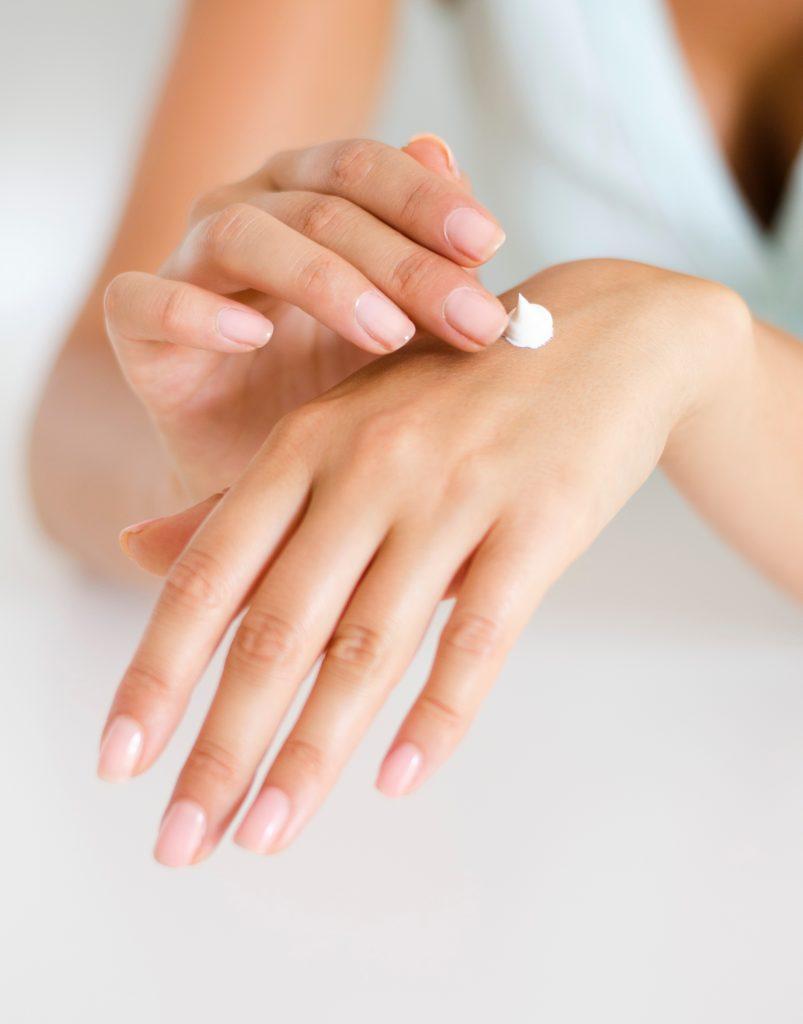 applying body lotion