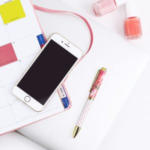 planner with pen and mobile